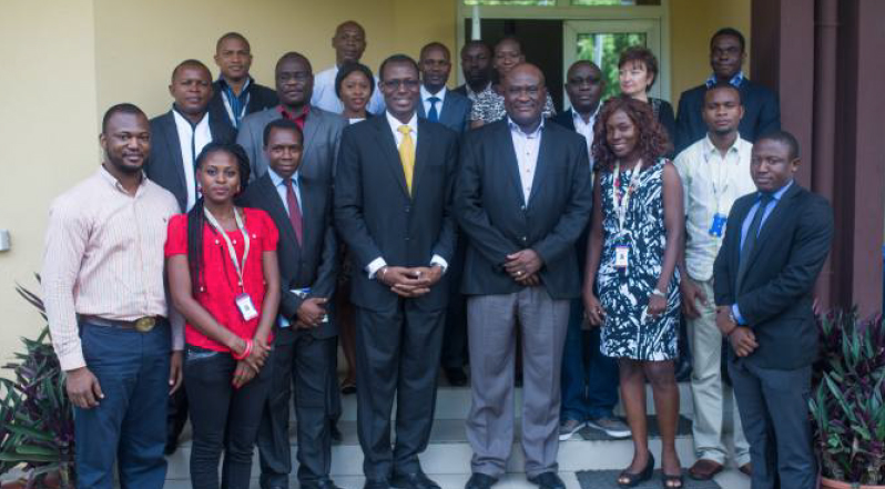 Michael Ikpoki(CEO, MTN Nigeria) in group photograph with Engr. Gbenga Adebayo (GCEO, CNSSL) and CNSSL Staff