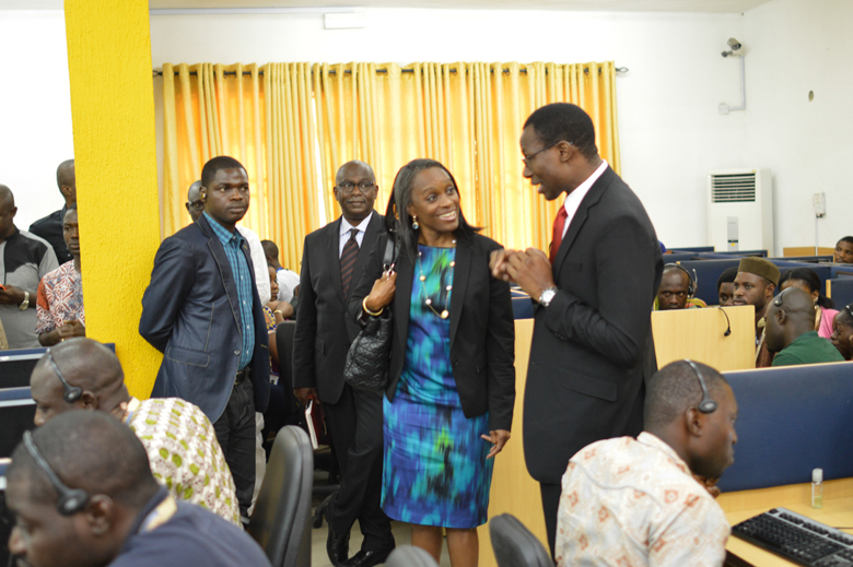 GCEO CNSSL Group, Engr. Gbenga Adebayo takes the Minister of Communication Technology, Mrs Omobola Johnson on a facility tour through the CNSSL Contact Centre operation floors (YELLOW ROOM)